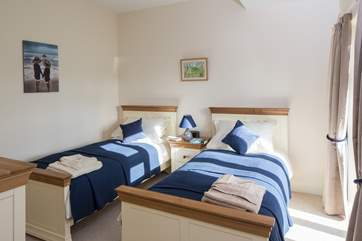 The light twin room has super comfy 3ft beds and a narrow French door looking over the garden.