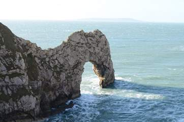 Dorset's iconic Durdle Door, with the Isle of Portland in the far distance.