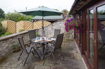 The south facing patio is perfect for afternoon tea.