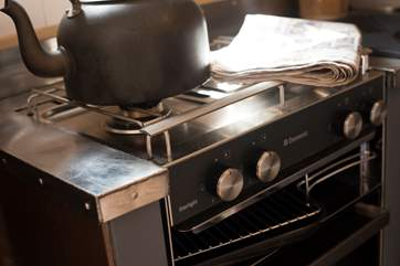 There is a an electric grill and mini oven and a two ring has hob and fridge all clevery designed to fit in.