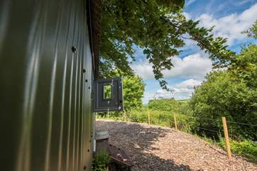 The hut enjoys lovely countryside views.