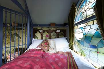 The gorgeous king-size bed has a window at the foot looking out over the countryside.