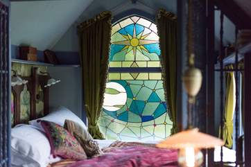 Wow, what a window, designed by the owner and bespoke made.