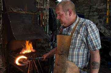 A blacksmith has a forge in the Barrow Centre.