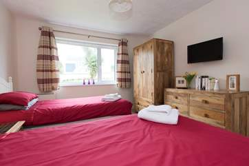 Beautiful solid wood furniture and a second TV in Bedroom 2.
