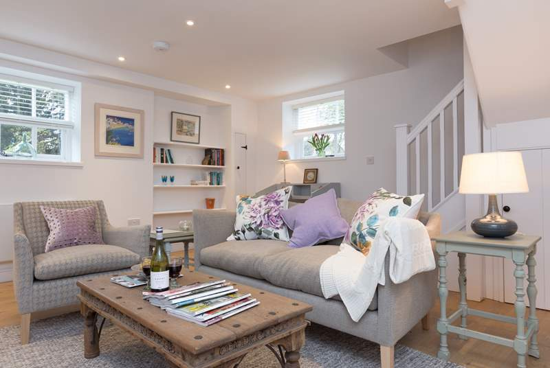 The beautifully presented living-room with a stylish mix of old and new to create a really welcoming feel.