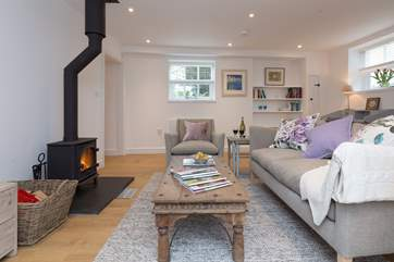 The living room has a lovely wood burning stove so that you will be as snug as you like whatever the time of year.