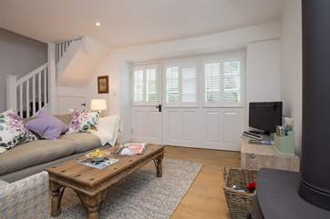 You can access the cottage through the lane door if you wish. The colonial style blinds give complete privacy yet the room is filled with light.