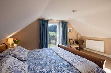The master bedroom has characterful sloping ceilings but plenty of space.