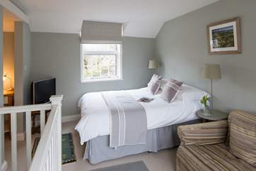 The calm and comfortable open plan sitting/bedroom