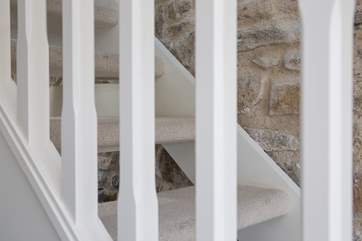 The open tread staircase up to the sitting/bedroom.