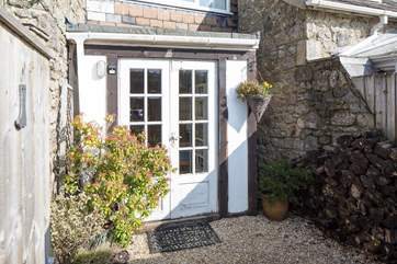 There is a little enclosed patio by the front door at the rear of the cottage.