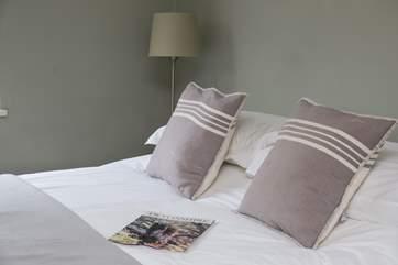 Crisp white linen on the bed.