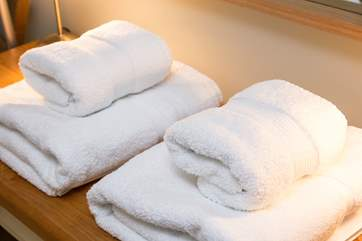 White fluffy towels are provided.