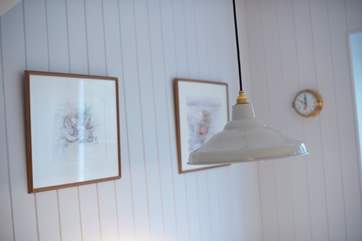 A retro light hangs low over the dining table.