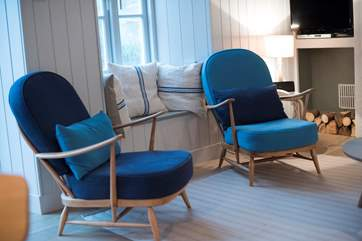 Refurbished Ercol armchairs are perfect in the living-room.