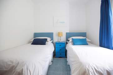 Bedroom 2 has twin beds plus a bespoke built-in cabin bed.