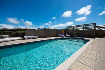 The outdoor swimming pool has wonderful views over Land's end from the decked area and complete privacy by the pool.
