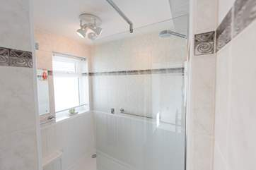 The gorgeous modern shower-room has a huge shower.