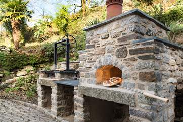 Enjoy cooking outdoors with the fabulous Pizza Oven and BBQ