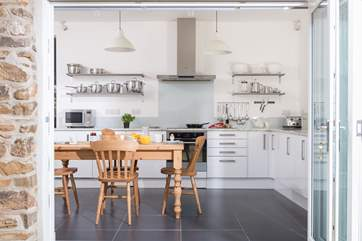 This fabulous kitchen/breakfast-room has folding doors to bring the outside in.