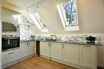 There is a super-contemporary kitchen fitted around this corner of the living space.