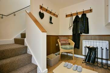 This is the ground floor entrance hallway - the thoughtful touch of slippers is a sign of the attention to detail here.