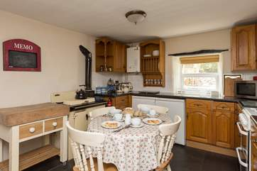 The homely kitchen has a breakfast table - the Rayburn is ornamental only - and plenty of storage space.