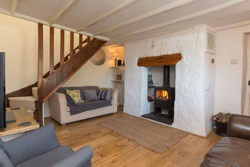 The sitting-room has a wood-burner so this cottage is a great place to stay whatever the time of year.