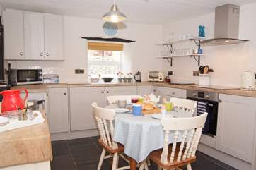 The kitchen has just been refurbished. Please note that the Rayburn is ornamental only - you have a brand new  fitted oven and hob for your cooking.