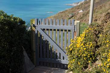 The gate to the pathway which leads up to the road or down to the beach.