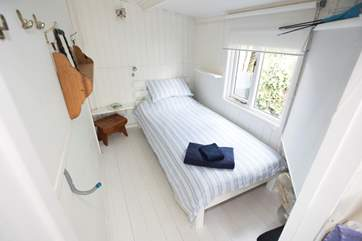 The single bedroom at the back of the cabin.