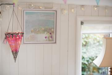 Pretty fairy lights add to the romance of the cabin.