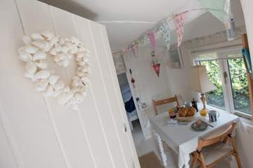 The pretty dining-area, with bunting and fairy lights adding to the charm.