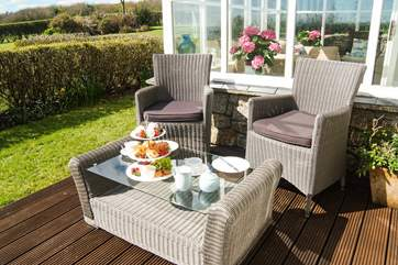 Enjoy a cream tea in the sunshine.