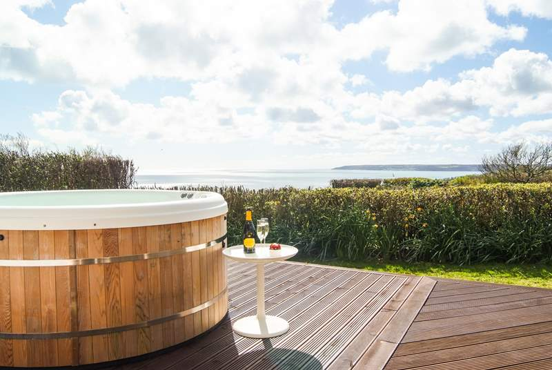 The hot tub has superb views out across Mount's Bay.