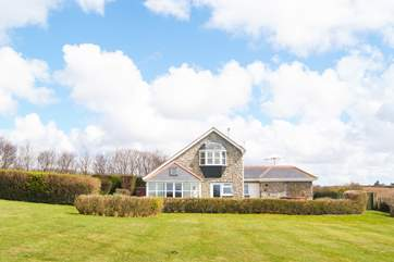 Sea Garden House is set within four acres of garden, paddock and woodland.