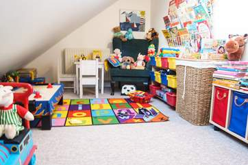 The playroom tucked into the eaves...so amazingly well-equipped you'll never get the little ones to leave!