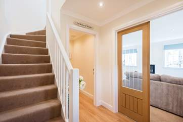 The hallway leads upstairs to the bedrooms and through to the sitting-room, kitchen and dining-room.