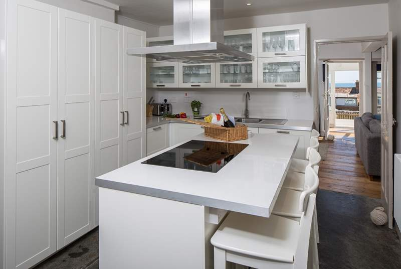 The very modern kitchen has the original slate floor, and all the appliances that you could need to create a romantic supper or a family feast.