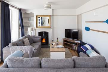 The stylish sitting room has a Smart TV and BT Vision with sports package and DVD player.