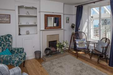 The sitting room has both modern comfy chairs and those from its original working days.