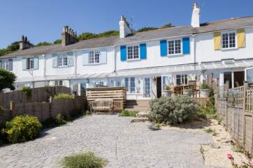 This beautiful row of Grade II listed cottages are south facing so enjoy the sun and sea views.