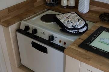 The kitchen is fully fitted with hob and mini oven, microwave, toaster and kettle too.