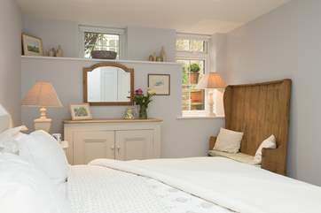 The bedroom is light and airy but cosy at the same time.