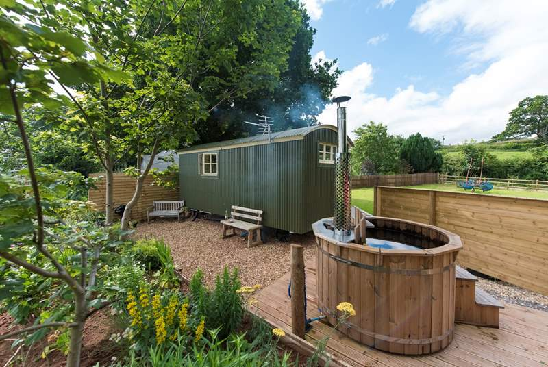Lamb's Tale is a delightful shepherd's hut, set in its own enclosed paddock with a hot tub (this has now been replaced by an electric version).