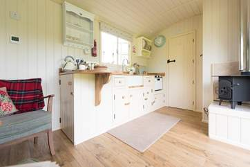 There is a cosy little wood-burner in the corner and underfloor heating too for the cooler months.