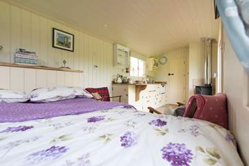 Looking across the hut from the lovely king-size bed to the en suite shower-room at the far end (behind the door).
