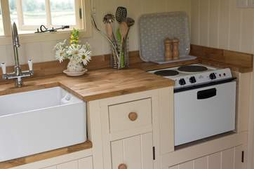 The kitchen is extremely well equipped - with a mini oven and hob, toaster and kettle too.
