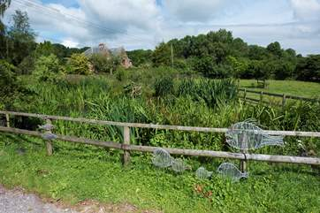 The entrance to the farm - just follow the farm track past the pond.